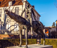 Four horsemen of Apocalypse statue in Bruges, Belgium.  Royalty Free Stock Photos
