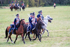 Four horses of different color and horse riders. Royalty Free Stock Image