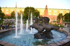 Four horses. Fountain with the Kremlin wall background Stock Photo