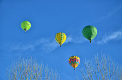 Four Hot Air Balloons in the air Stock Images