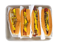 Four hot dogs with condiments Stock Photo