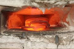 Four hot shoes. Horseshoes are heated up in the furnace so the blacksmith can shape them to fi the horses hoof Stock Image