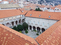 Four houses together and a garden. Little garden betwen houses in Dubrovnik royalty free stock photos