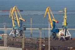 Four huge industrial cranes at the commercial dock Stock Photography