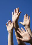 Four human hands raised up Royalty Free Stock Photography