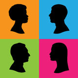 Four human head silhouettes profile. Four vector silhouettes of human head in profile. Two women and two men of various races and ethnicities. Black  silhouettes Stock Photos