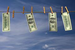 Four hundred dollar bills hanging on a clothesline Stock Image