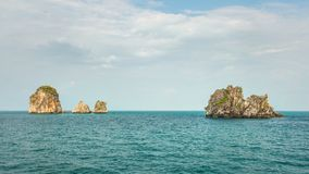 Four of hundreds small uninhabited karst rocky islands. With green flora on top. Andaman sea between Phi Phi and Ao Nang, Thailand Royalty Free Stock Photography