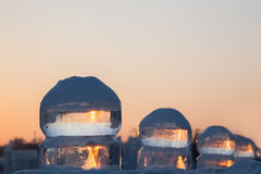 Four ice balls at sunset in winter Royalty Free Stock Photos