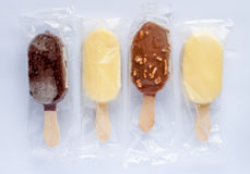 Four ice creams in plastic transparent bags Royalty Free Stock Photos