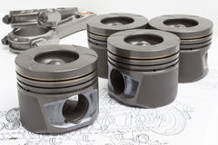 Four identical pistons on white background. spare internal combustion engine Stock Images