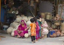 Four Indian Children are walking around the market Royalty Free Stock Photos