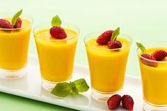 Four individual vanilla desserts Stock Photography