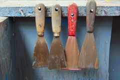 Four ink spatulas in a row at a printing company Royalty Free Stock Photo