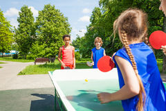 Four international friends play table tennis Royalty Free Stock Photography