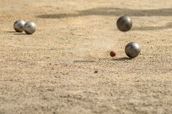 Petanque, game and sport with iron balls colliding with each other Royalty Free Stock Images