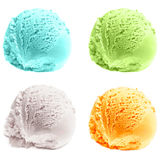 Four isolated scoops of ice cream. royalty free stock photo