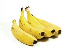 Four Isolated Yellow Ripe Bananas on White Stock Photos