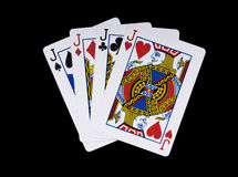 Four  Jacks. Poker hand shot on black Stock Photo