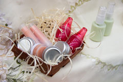 Four jars of cream, two lipsticks, two lip balm in a bright jar Royalty Free Stock Photo
