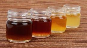 Four jars full of honey, mix taste Stock Photos