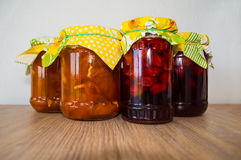 Four jars of jam on wooden table Royalty Free Stock Photo