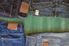 Four of jeans and chalkboard background Royalty Free Stock Photography