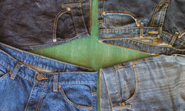 Four of jeans on chalkboard Royalty Free Stock Photography