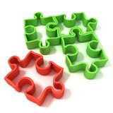 Four jigsaw puzzle outlined pieces Stock Photography