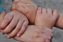 four joined hands Royalty Free Stock Photos