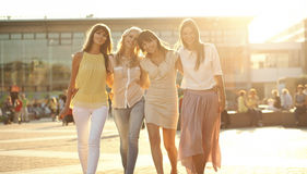 Four joyful girlfriends on the walk Royalty Free Stock Photos