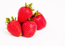 Four juicy strawberries Royalty Free Stock Photo