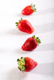 Four juicy strawberry on the table Stock Photo
