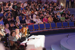 Four jurors sitting at the table during cosplay contest Royalty Free Stock Photography