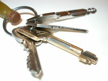 Four keys. On the table (white background royalty free stock images