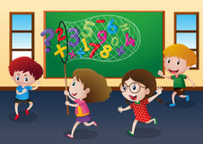 Four kids catching numbers in classroom Royalty Free Stock Images