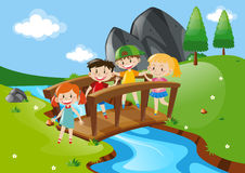 Four kids crossing bridge Royalty Free Stock Images