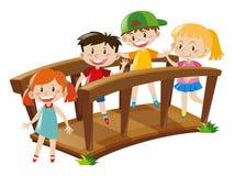 Free Four Kids Crossing Wooden Bridge Stock Photos - 79891563