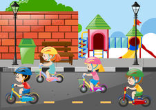Four kids cycling on the road. Illustration Stock Photos