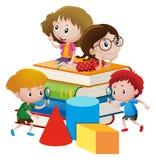 Four kids on giant books Stock Photos