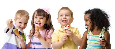 Happy kids group eating ice cream isolated on white royalty free stock images