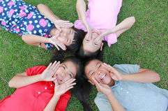 Four kids having fun in the park. Stock Photos