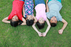 Four kids having fun in the park. Royalty Free Stock Image