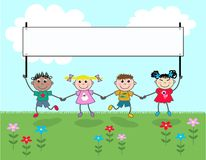 Four kids holding a banner Royalty Free Stock Images