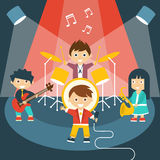 Four kids in a music band Stock Images