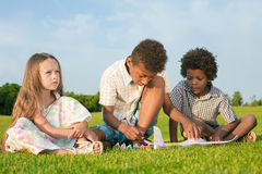 Four kids are painting. Royalty Free Stock Images