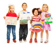Four kids with pictures in their hands Stock Photo