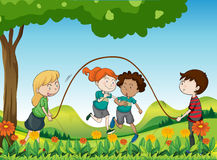 Four kids playing under the tree Stock Images
