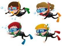 Four kids scuba diving underwater Stock Image