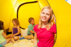 Four kids sit in a tent Stock Images
